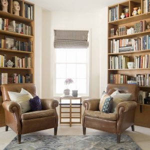 Two leather chairs with bookshelves in the background in a custom home in Stamford, Greenwich & New Canaan, CT