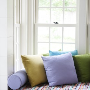 colorful couch next to a window